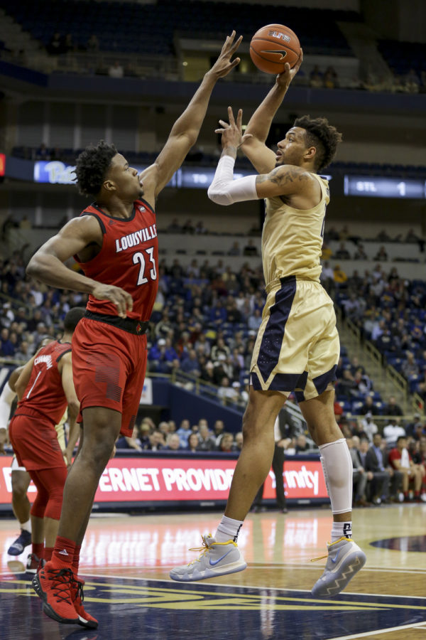 Sophomore center Terrell Brown (21) , pictured here against Louisville, scored 10 points and led Pitt with eight rebounds against NC State.