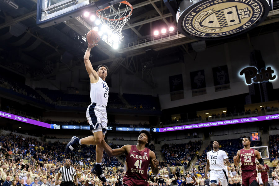 First-year+guard+Trey+McGowens+attempts+a+dunk+during+Pitt%E2%80%99s+75-62+victory+over+Florida+State+Monday+evening.+%0A