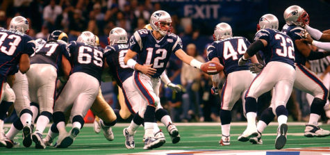 New England Patriots quarterback Tom Brady (12) hands the ball off to Antowain Smith (32) during Super Bowl XXXVI at the Louisiana Superdome.