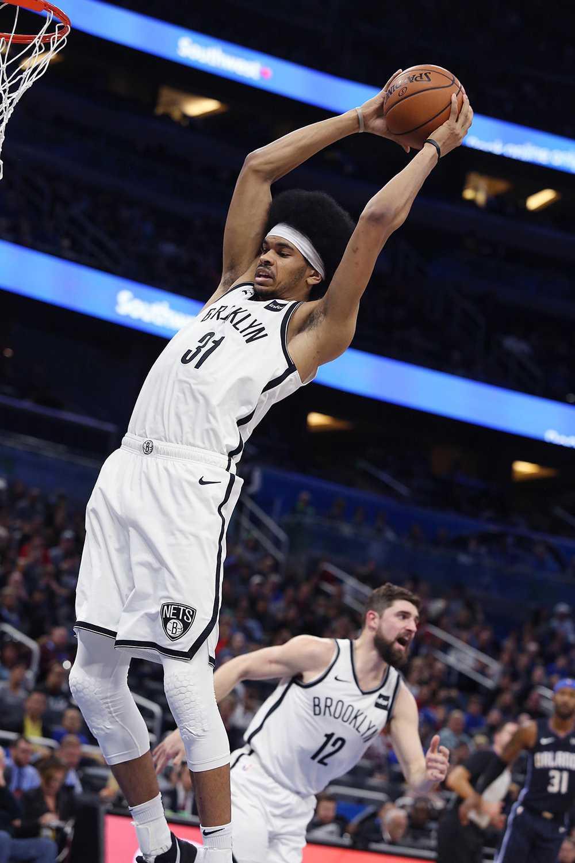 The Brooklyn Nets' Jarrett Allen pulls down a rebound against the Orlando Magic on Friday, Jan. 18.