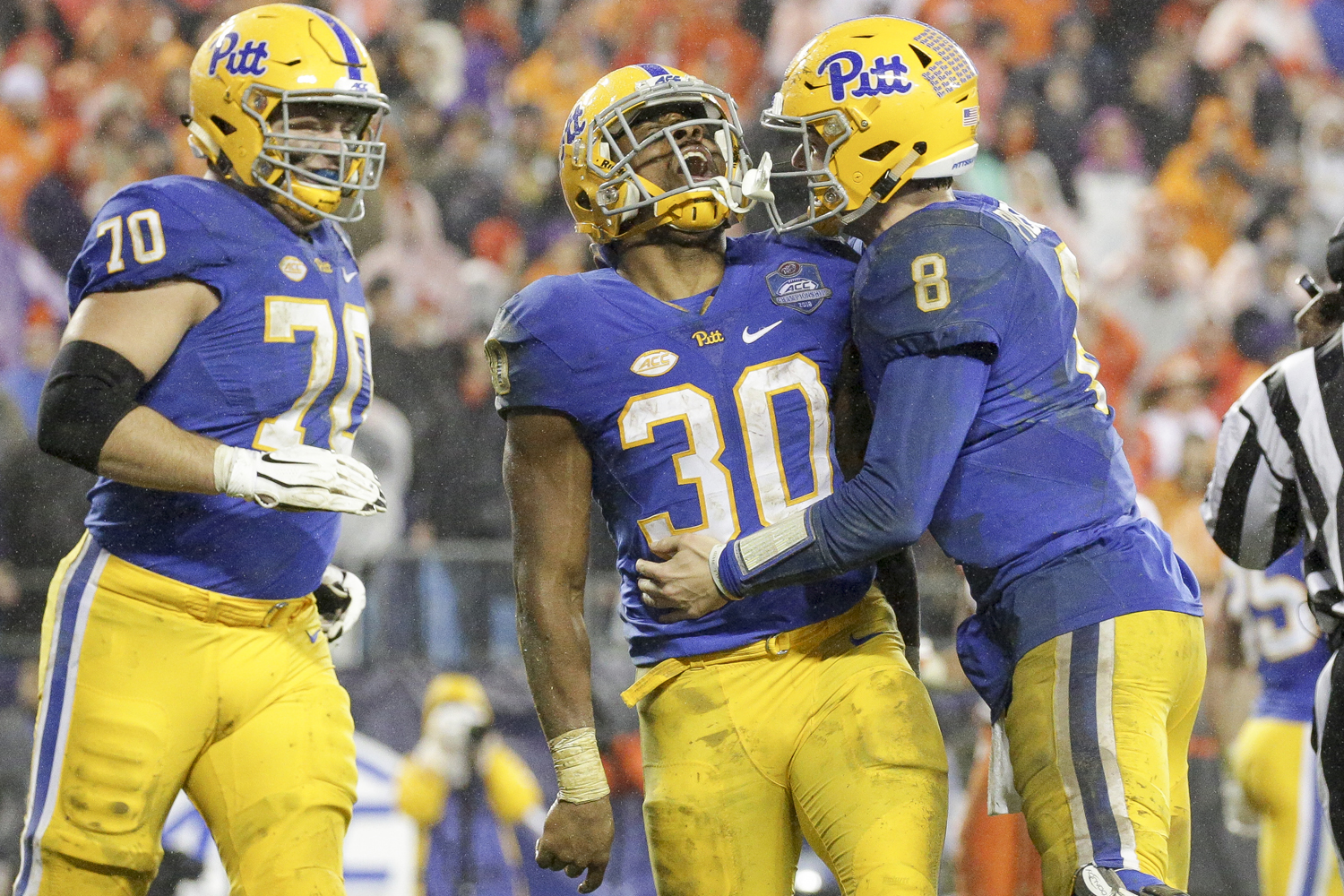 Kenny Pickett (8) and Qadree Ollison (30) celebrate after a successful play during the team's loss to Clemson in the ACC Championship Game.
