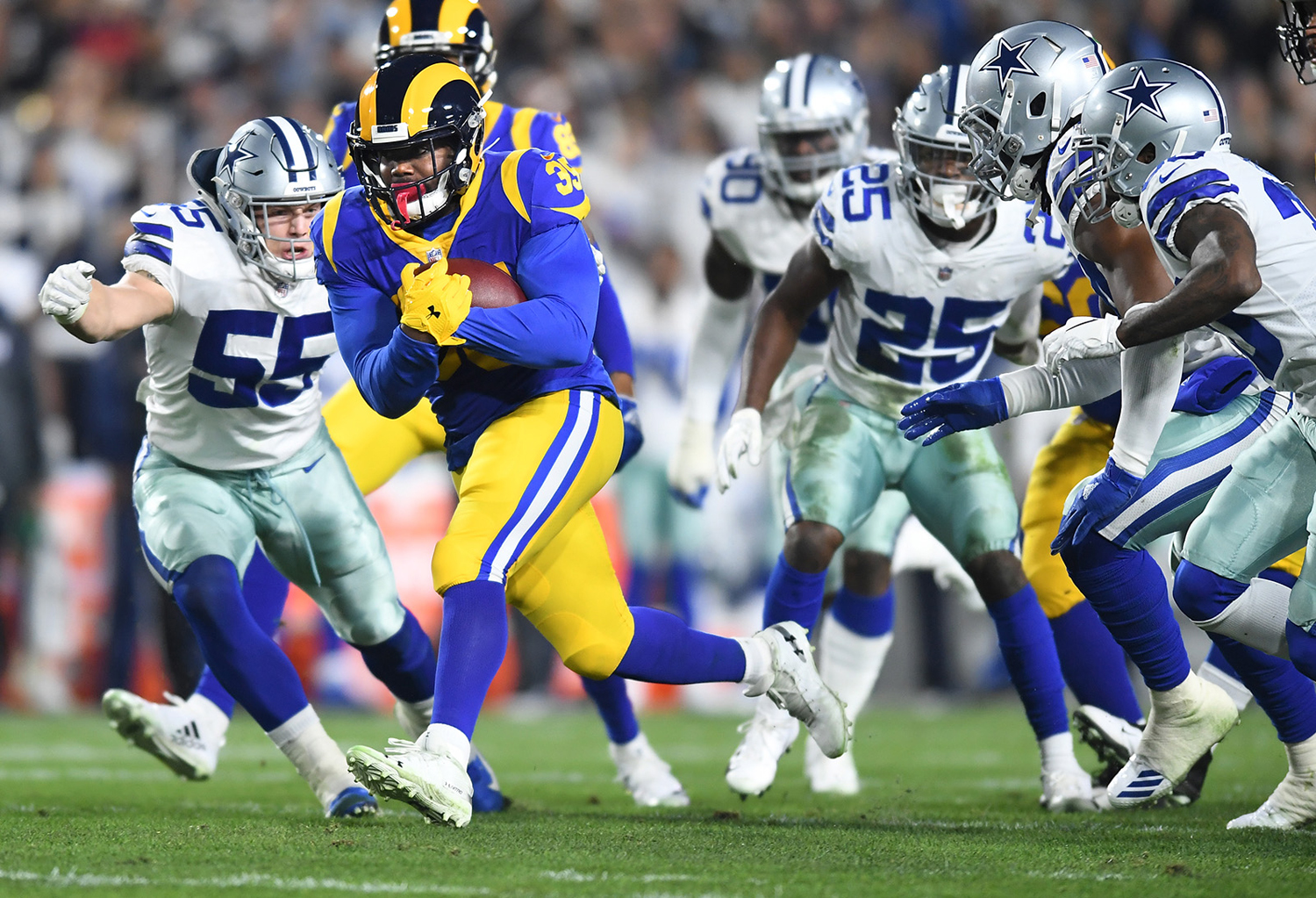 Los Angeles Rams running back C.J. Anderson picks up yards against the Dallas Cowboys in the first quarter during the NFL Divisional Round at the Los Angeles Memorial Coliseum on Saturday.