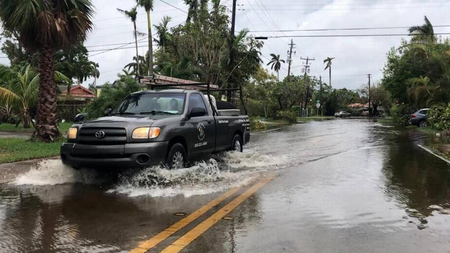 King tide brought high waters that flooded several low-lying streets on Normandy Isle in North Beach on Oct. 5, 2017. New research shows that lower elevation single-family homes, which are more vulnerable to sea level rise, gain value slower than their higher elevation peers.