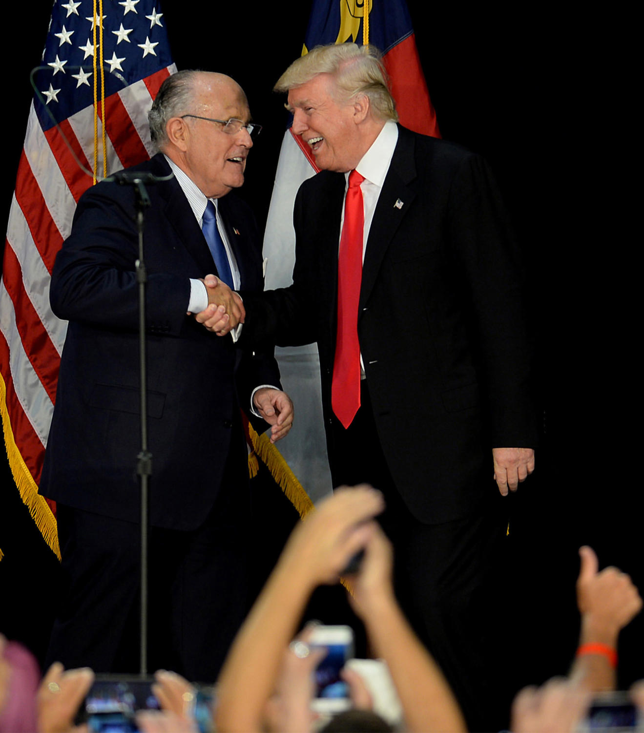 Former New York City mayor Rudy Giuliani, left, welcomes Republican presidential candidate Donald Trump on stage during a campaign rally on Aug. 18, 2016, at the Charlotte Convention Center in Charlotte, N.C.