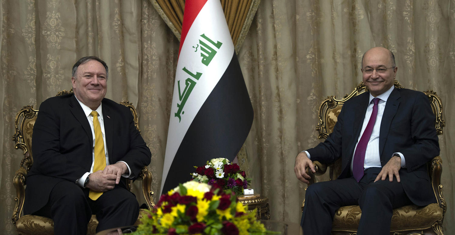 US Secretary of State Mike Pompeo, left, meets with Iraq's President Barham Salih in Baghdad, during a Middle East tour, on Jan. 9, 2019.