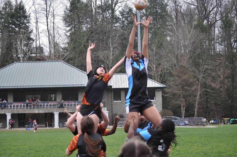 The Woodland Hills Girl's Rugby team, pictured here in blue, lost only three of its games in its first season.