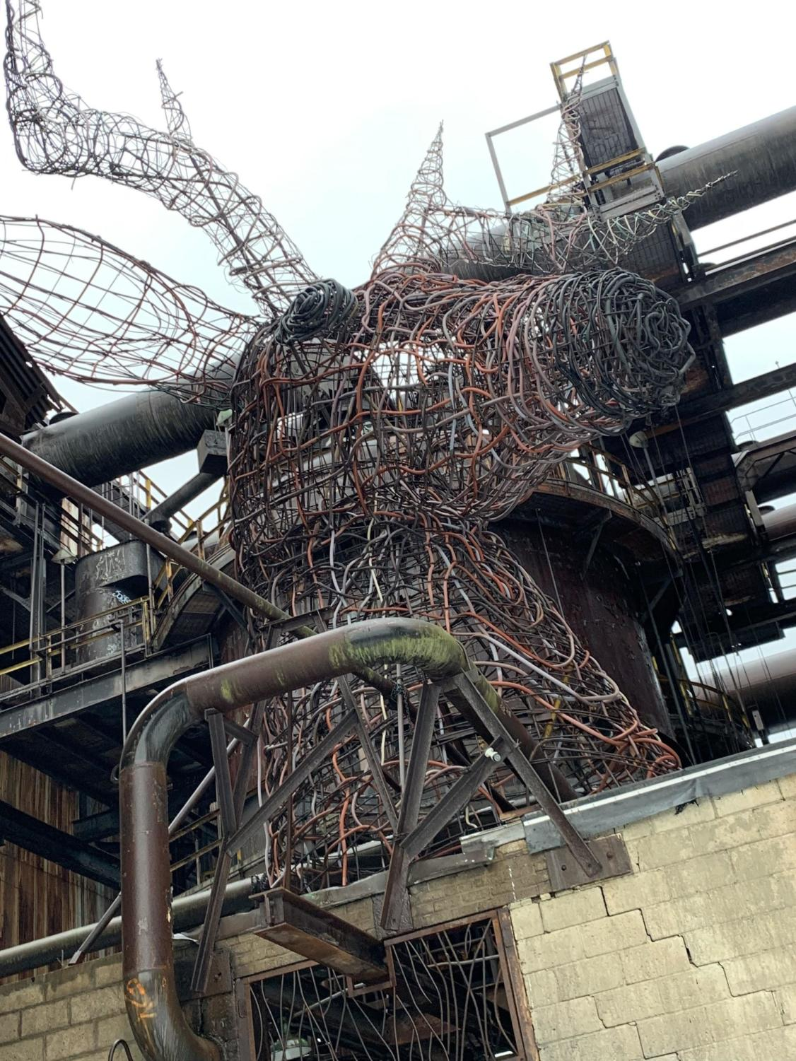 Art installations, like the deer head featured here, are revitalizing the abandoned Carrie Furnace, along with walls of legal graffiti.