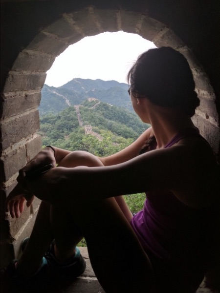 Copy Chief Kim Rooney looks out over the Great Wall of China during her summer study abroad program.