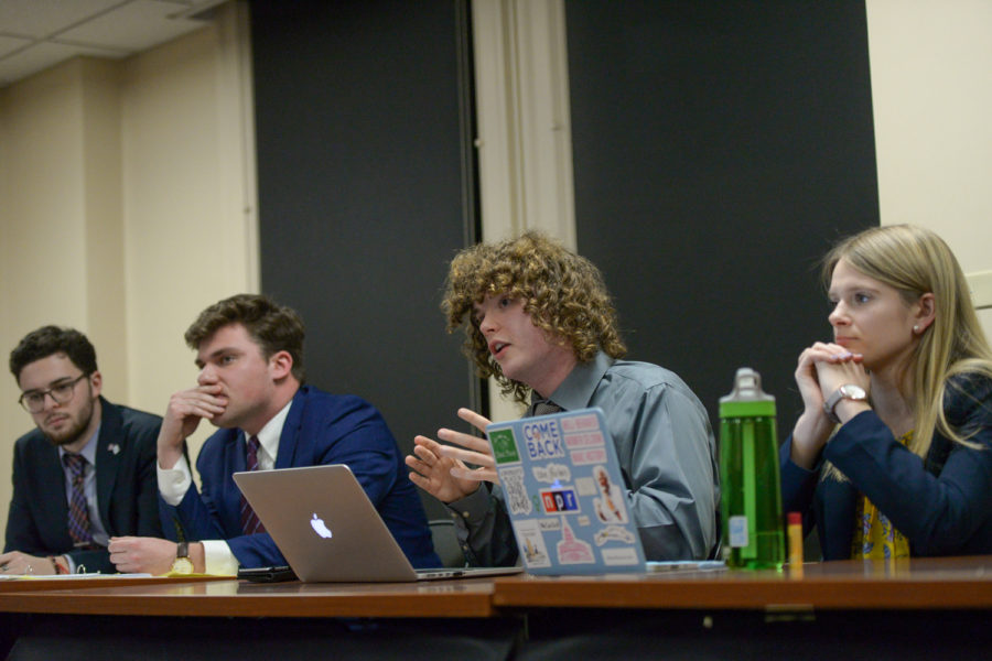Pitt College Republicans' Corey Barsky (far left) and Phil Saggese (center left) listen as Pitt College Democrats' Mackenzie Coat (center right) and Maureen Hartwell (far right) speak during Monday evening's health-care debate.