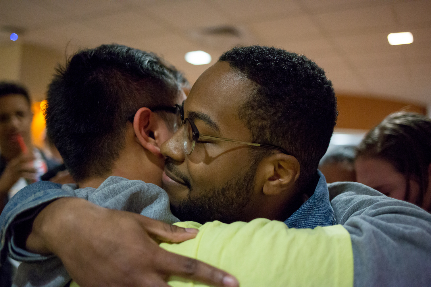 SGB presidential candidates Zechariah Brown (front) and Albert Tanjaya hug after the announcement of Tuesday's election results.