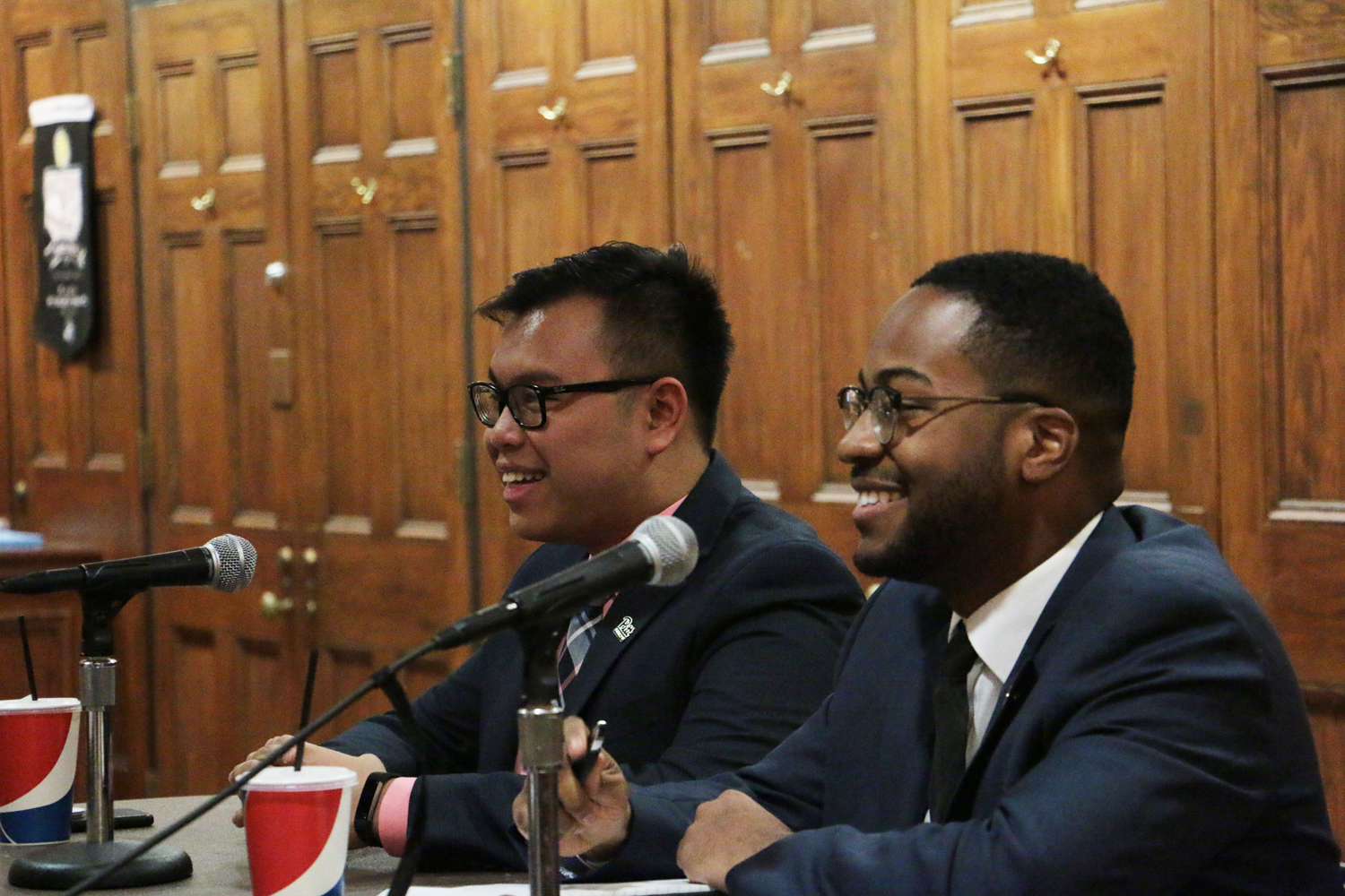 SGB presidential candidates Albert Tanjaya (left) and Zechariah Brown (right) discuss the funding process for Pitt's clubs at Monday evening's SGB Presidential Debate.