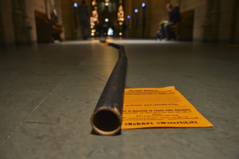 "Members of the Fossil Free Pitt Coalition set up a cardboard ""pipeline"" in the Cathedral in December 2016 in protest of the pipeline on Standing Rock"