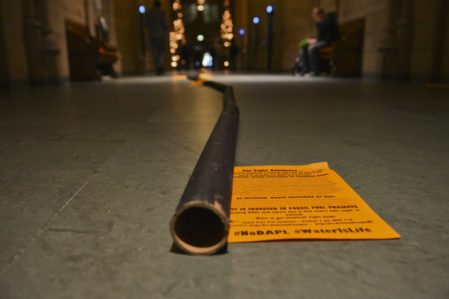 """Members of the Fossil Free Pitt Coalition set up a cardboard """"pipeline"""" in the Cathedral in December 2016 in protest of the pipeline on Standing Rock's reservation."""