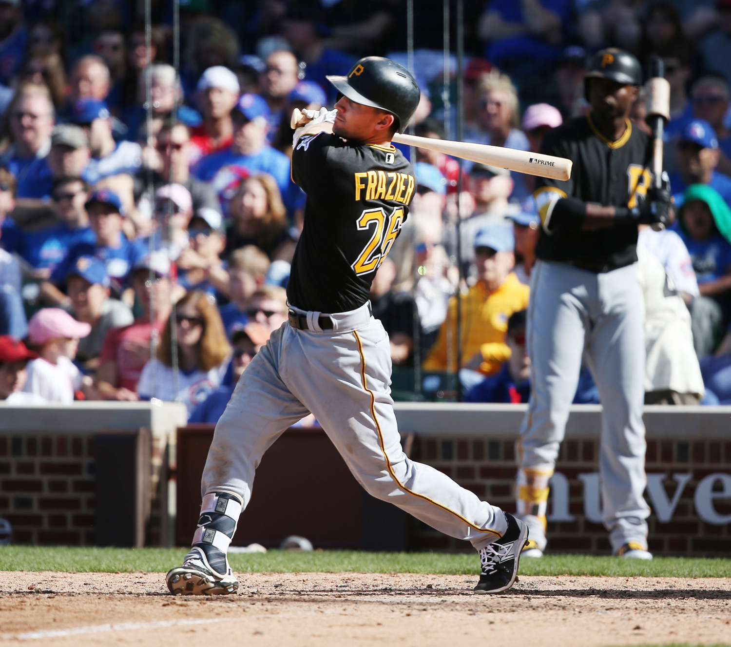 Pittsburgh Pirates left fielder Adam Frazier (26) watches the flight of his three-run home run against the Chicago Cubs during the ninth inning on April 16, 2017, at Wrigley Field in Chicago.