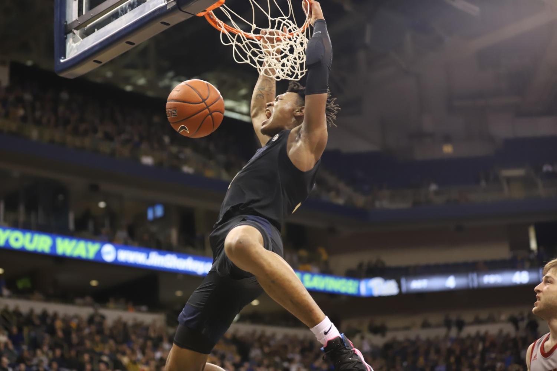 First-year forward Au'Diese Toney throws down a dunk.