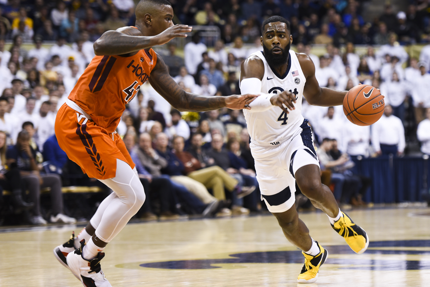 Senior guard and forward Jared Wilson-Frame (4), pictured here against Virginia Tech on Feb. 16, led all Pitt scorers with 19 points.
