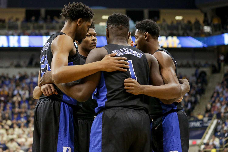 The Duke men's basketball team huddles during January's matchup with Pitt.