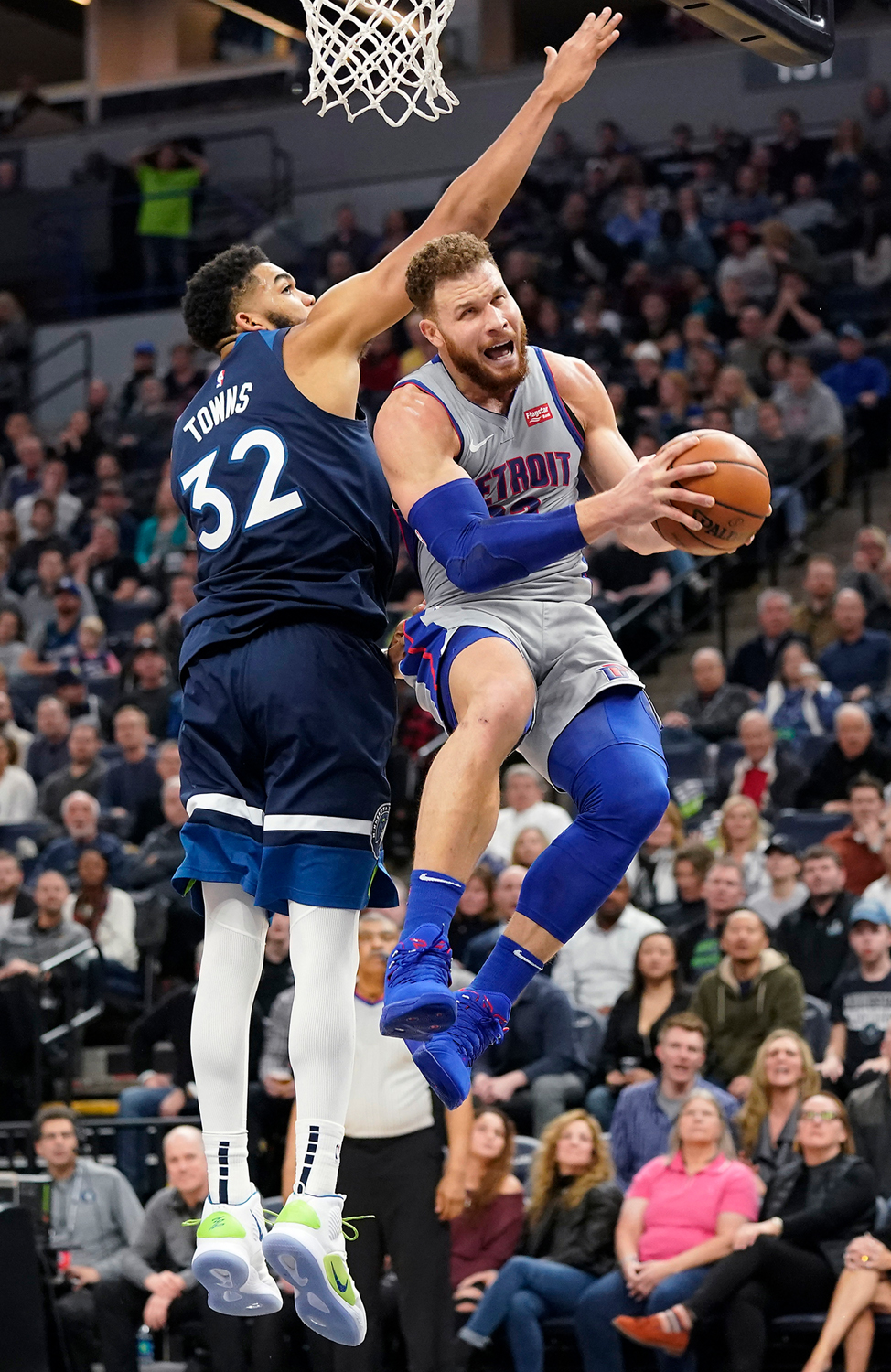The Detroit Pistons' Blake Griffin shoots as the Minnesota Timberwolves' Karl-Anthony Towns (32) defends during the second half at Target Center in Minneapolis on Wednesday, Dec. 19, 2018. The Pistons won, 129-123, in overtime.