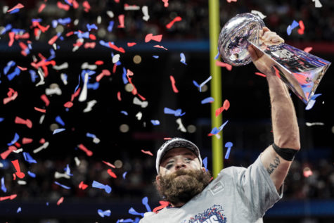 Super Bowl MVP Julian Edelman hoists the Lombardi Trophy after the New England Patriots beat the Los Angeles Rams, 13-3, in Super Bowl LIII at Mercedes-Benz Stadium in Atlanta on Sunday.