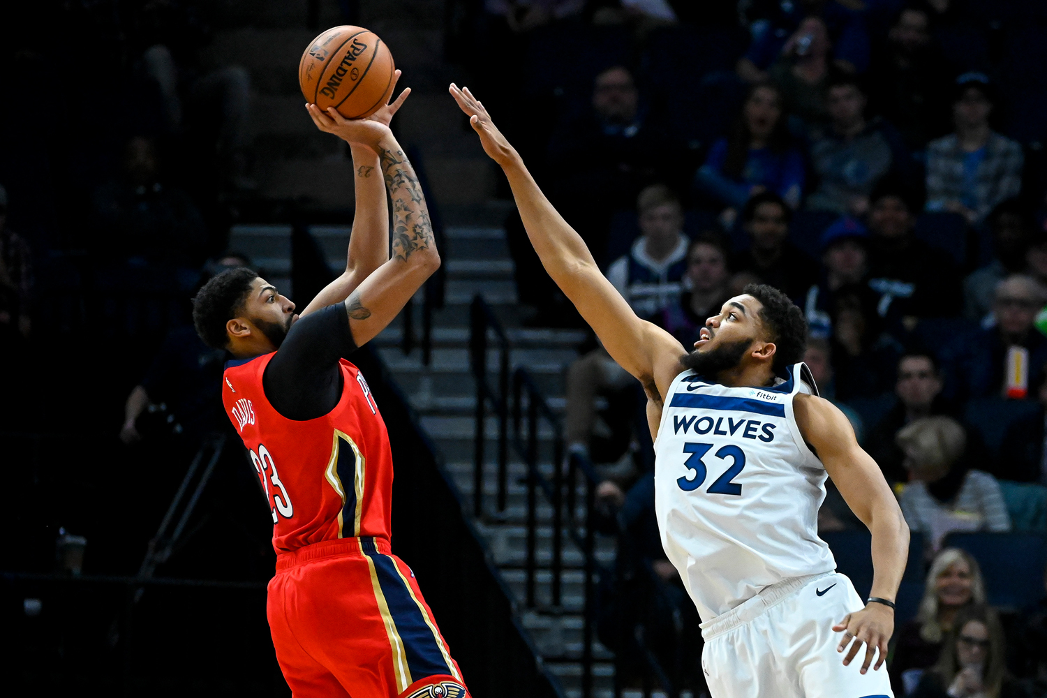 The Minnesota Timberwolves' Karl-Anthony Towns (32) pressures a 3-point attempt by the New Orleans Pelicans' Anthony Davis (23) in the first half on Wednesday, Nov. 14, 2018, at Target Center in Minneapolis.