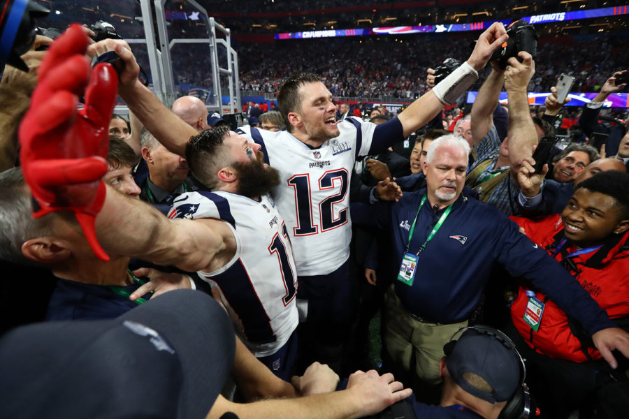 New England Patriots wide receiver Julian Edelman (11) and quarterback Tom Brady (12) celebrate a 13-3 win against the Los Angeles Rams in Super Bowl LIII at the Mercedes-Benz Stadium in Atlanta on Sunday.