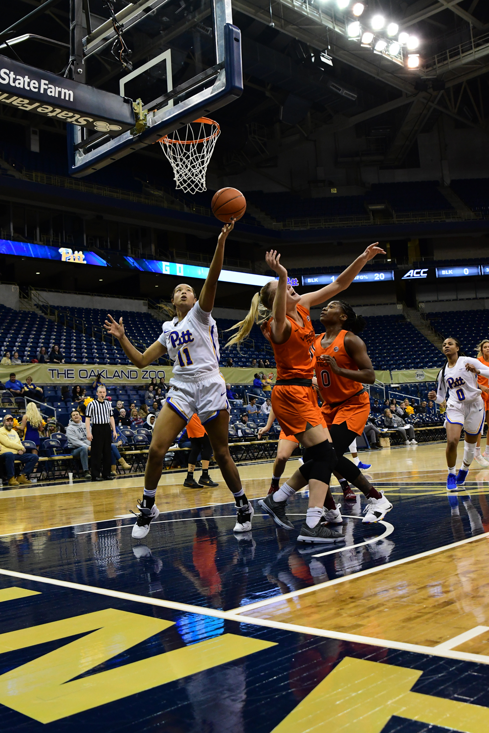 Sophomore center Cara Judkins (11) attempts a layup during Pitt's Jan. 31 loss against Virginia Tech. Yesterday's loss against Duke marked Pitt's ninth straight loss this season.
