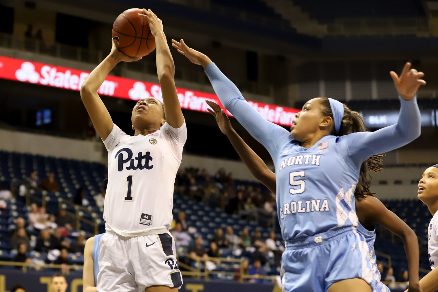 Senior forward Danielle Garven (1) attempts a layup during Pitt's 91-78 victory over North Carolina on Thursday evening.