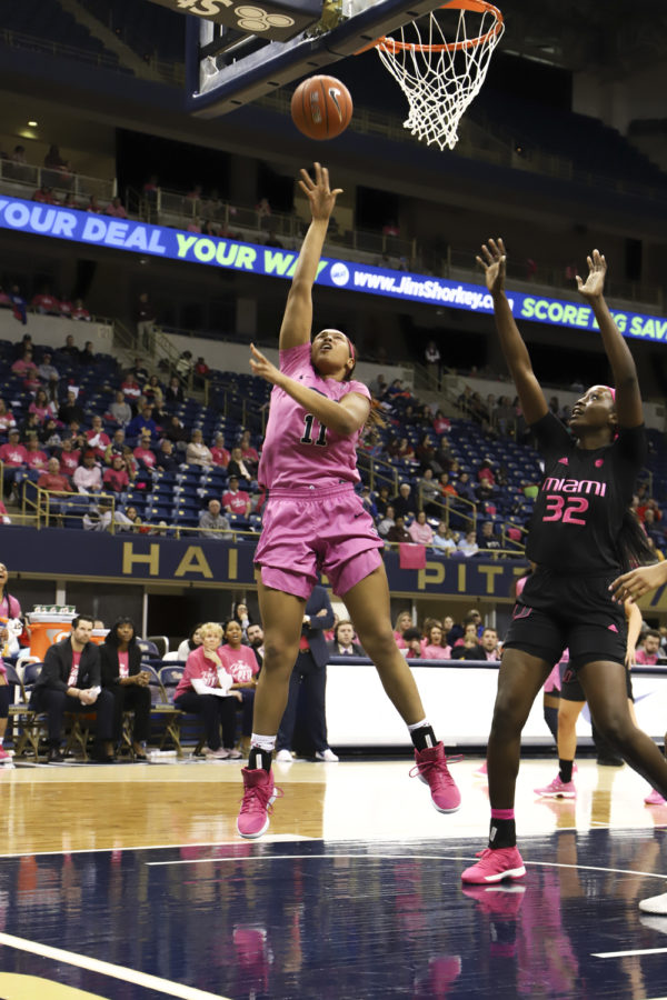Sophomore+center+Cara+Judkins+%2811%29+attempts+a+layup+during+Sunday%E2%80%99s+Pink+the+Petersen+game+against+Miami.+