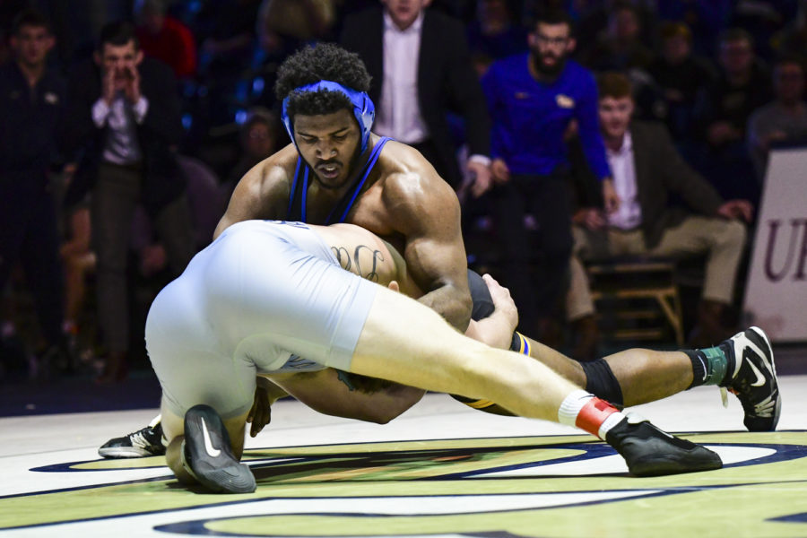 Junior+Demetrius+Thomas%2C+pictured+here+against+North+Carolina+on+Feb.+2%2C+won+his+match+against+Deonte+Wilson+of+NC+State+and+helped+Pitt+wrestling+break+their+3-match+losing+streak.+