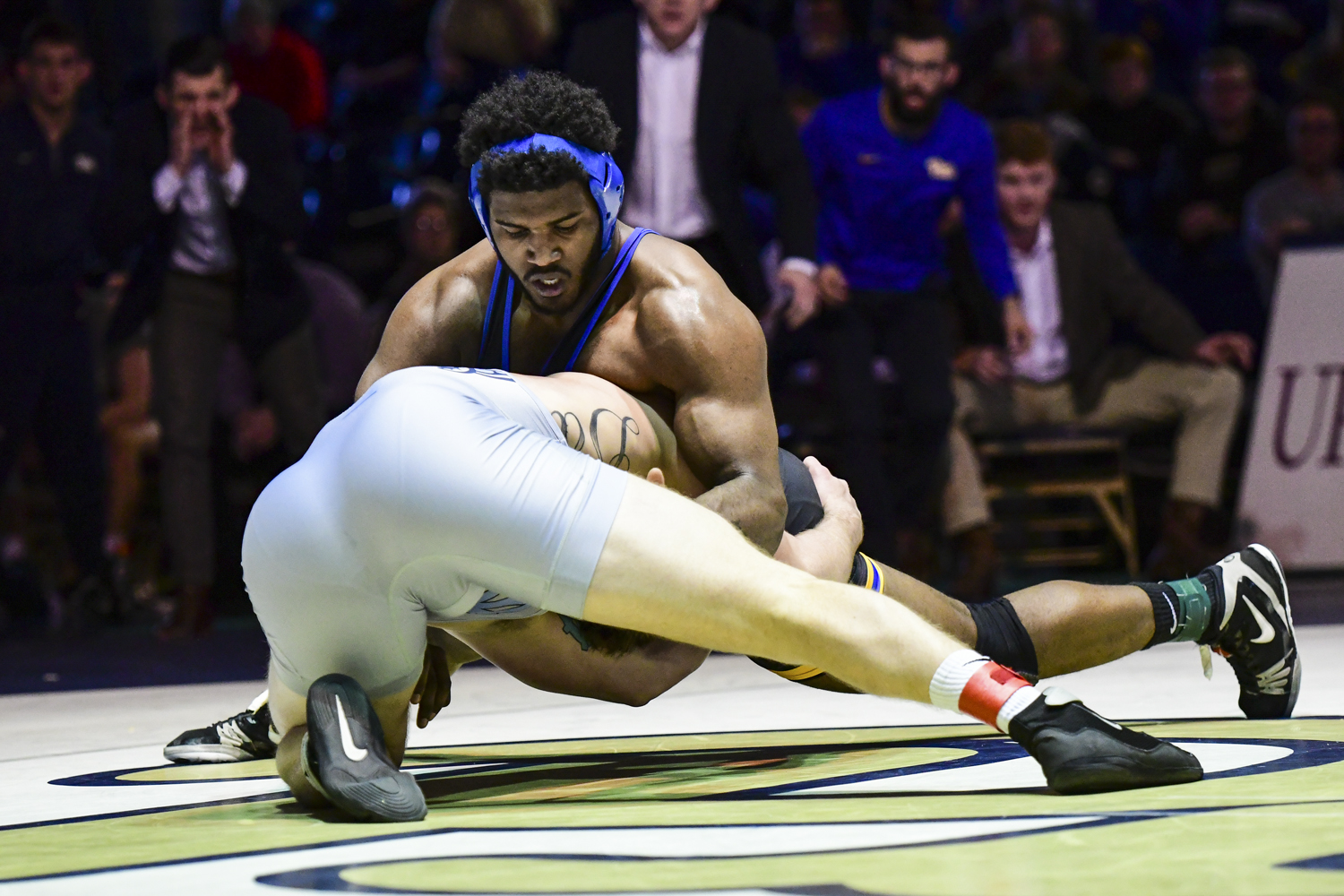 Junior Demetrius Thomas, pictured here against North Carolina on Feb. 2, won his match against Deonte Wilson of NC State and helped Pitt wrestling break their 3-match losing streak.