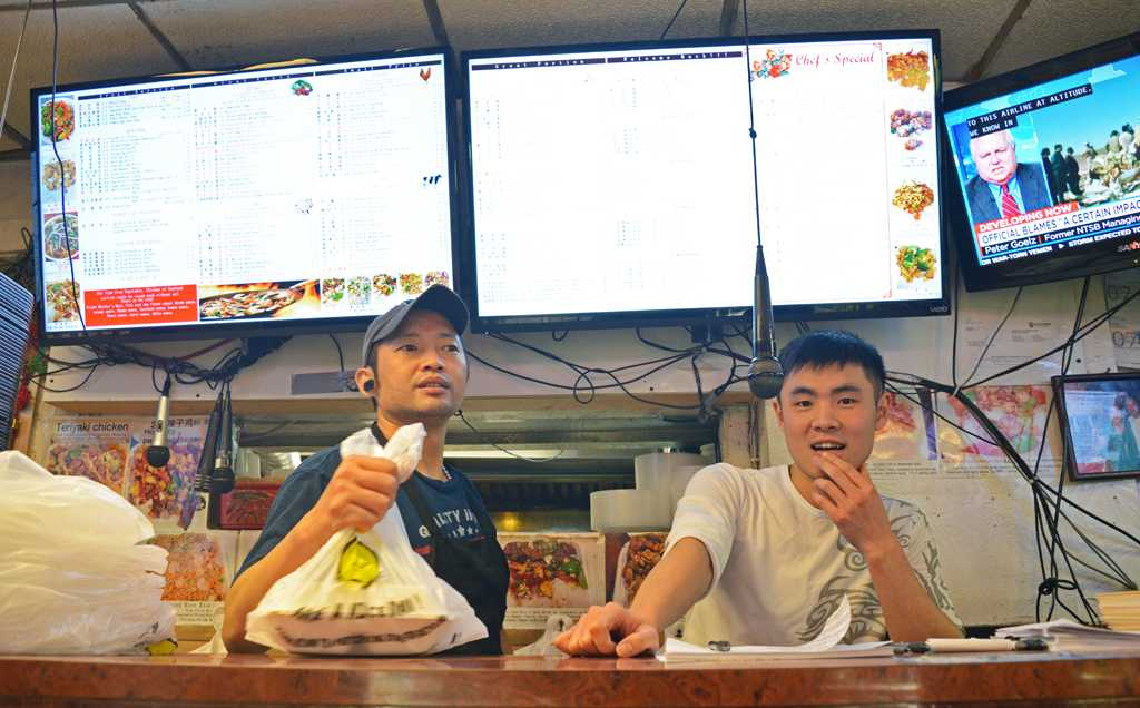 Szechuan serves customers at their storefront on Oakland Avenue.