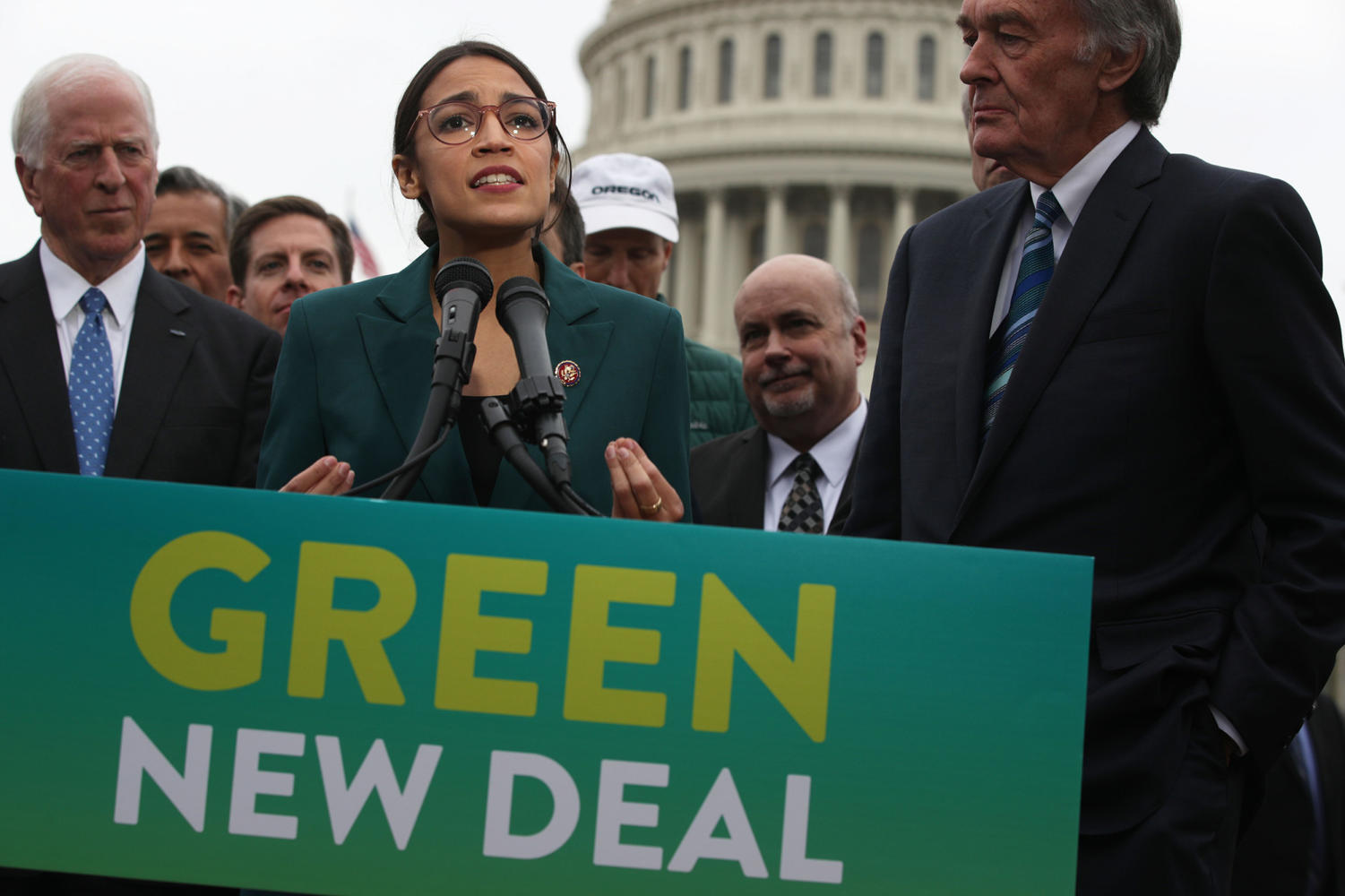 Rep. Alexandria Ocasio-Cortez (D-N.Y.) speaks as Sen. Ed Markey (D-Mass.), right, and other Congressional Democrats listen during a news conference in front of the U.S. Capitol on Thursday, Feb. 7, 2019, in Washington, DC.