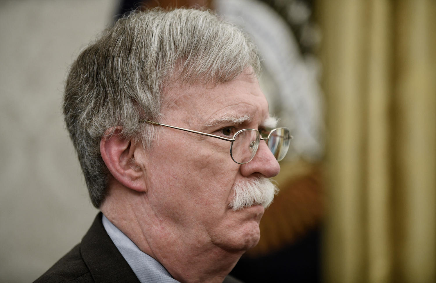 National security adviser John Bolton listen to U.S. President Donald Trump about the new directive centralizing all military space functions under a new Space Force, which will be overseen by the Department of the Air Force, in the Oval Office of the White House on Tuesday, February 19, 2019, in Washington, D.C.