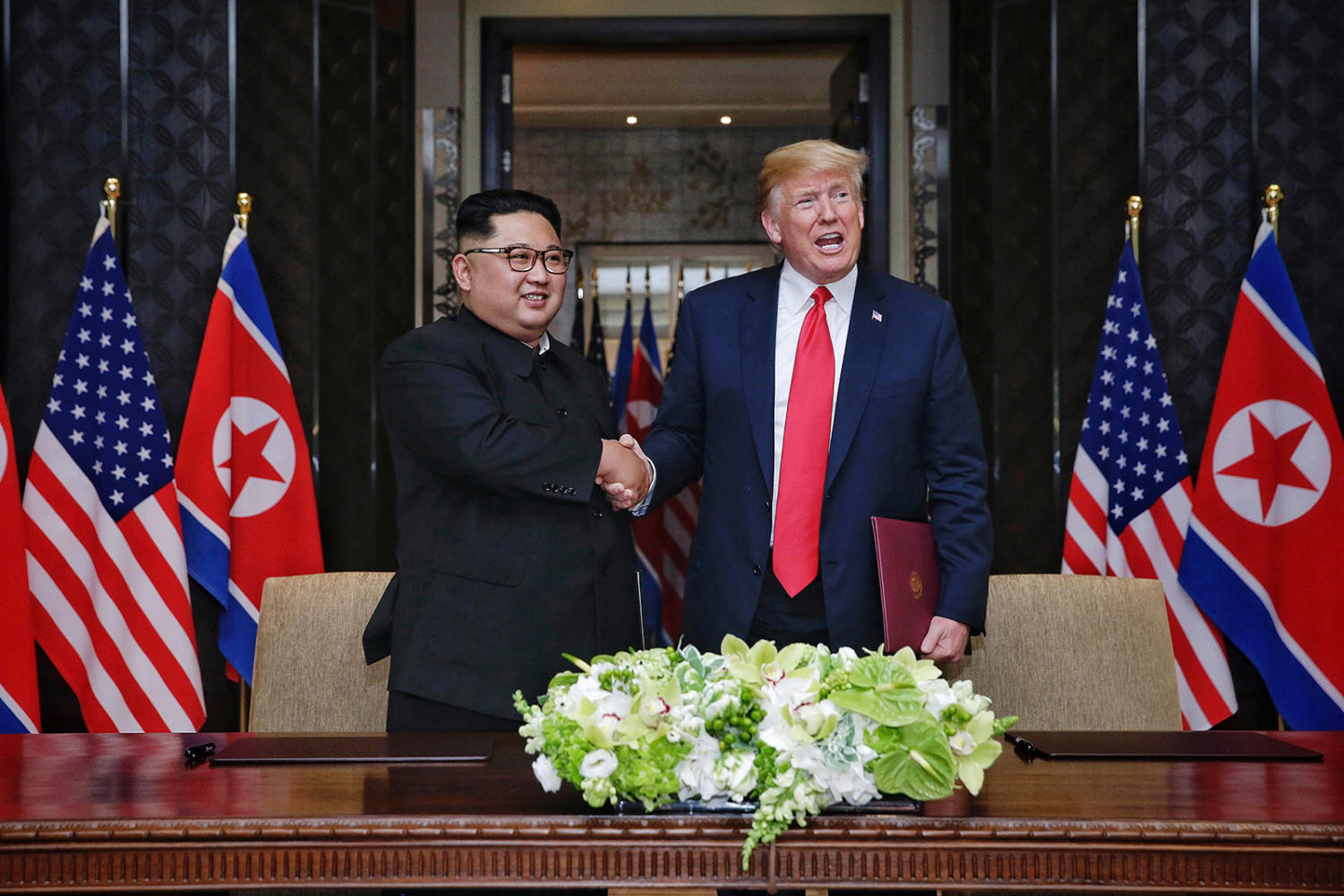 On June 12, 2018, in Singapore, President Donald Trump and North Korean leader Kim Jong Un shake hands after signing an agreement at the Capella Hotel.