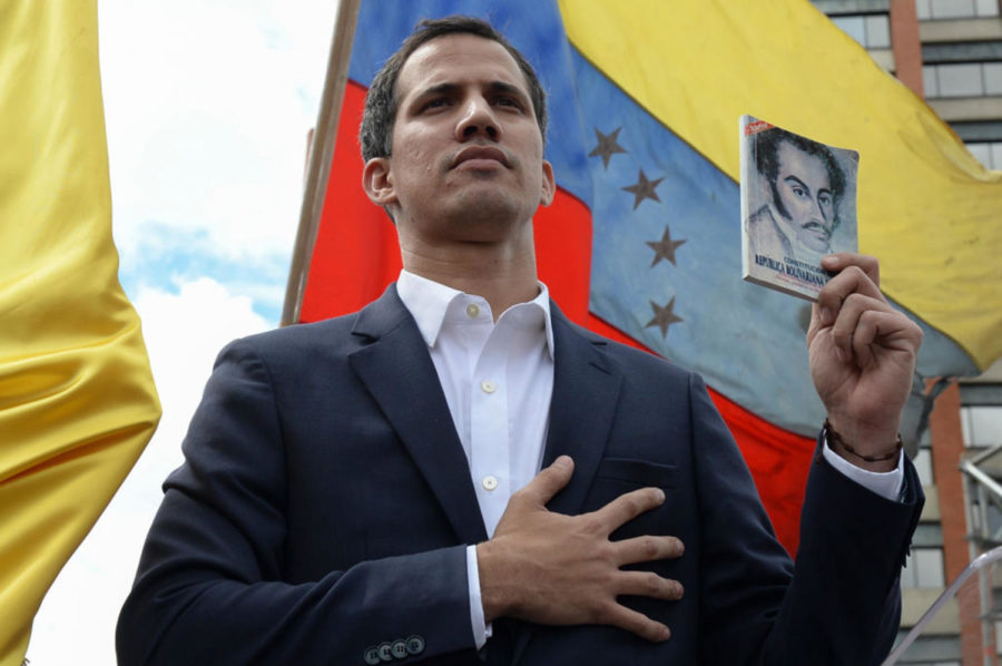 Venezuela%27s+National+Assembly+head+Juan+Guaido+declares+himself+the+country%27s+%22acting+president%22+during+a+mass+opposition+rally+against+leader+Nicolas+Maduro%2C+on+the+anniversary+of+a+1958+uprising+that+overthrew+military+dictatorship+in+Caracas+on+January+23%2C+2019.+