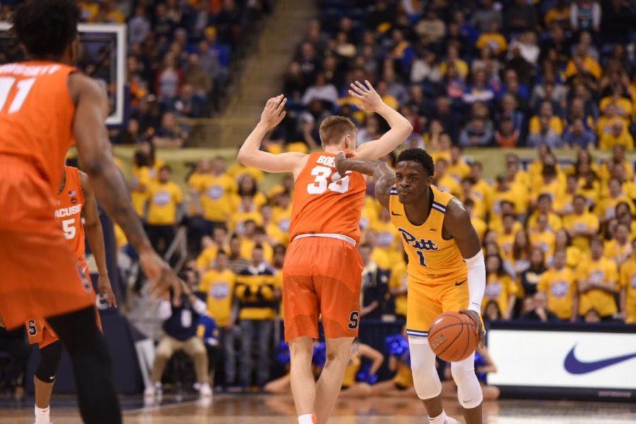 First-year+guard+Xavier+Johnson+%281%29+drives+past+Syracuse+defender+Buddy+Boeheim+%2835%29.