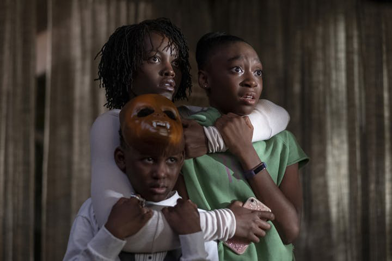 "Adelaide (Lupita Nyong'o) fights to keep Jason (Evan Alex) and Zora (Shahadi Wright Joseph) safe in Jordan Peele's second film, ""Us."""