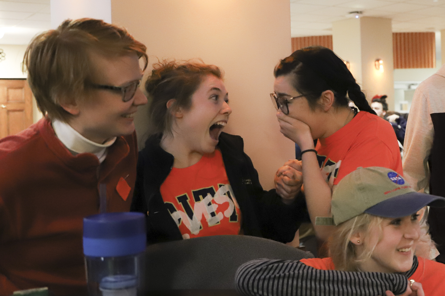 Anaïs Peterson (top right) and members of Fossil Free Pitt react to hearing that Peterson won the runoff election for SGB executive vice president.