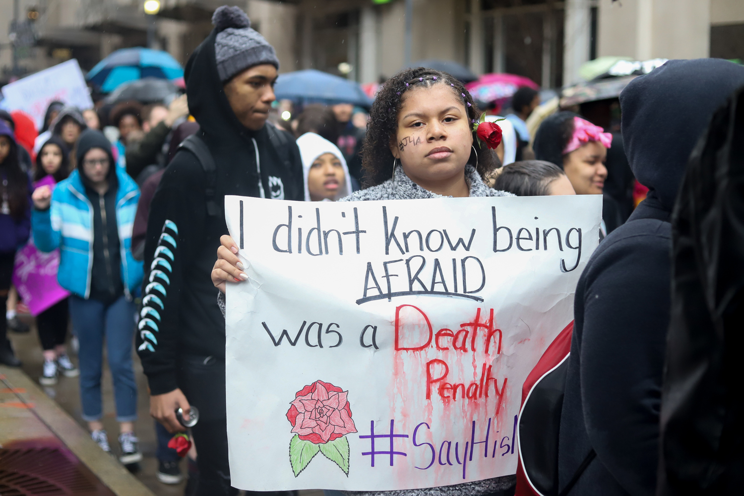 Demonstrators march through downtown Pittsburgh during Monday's student walkout.
