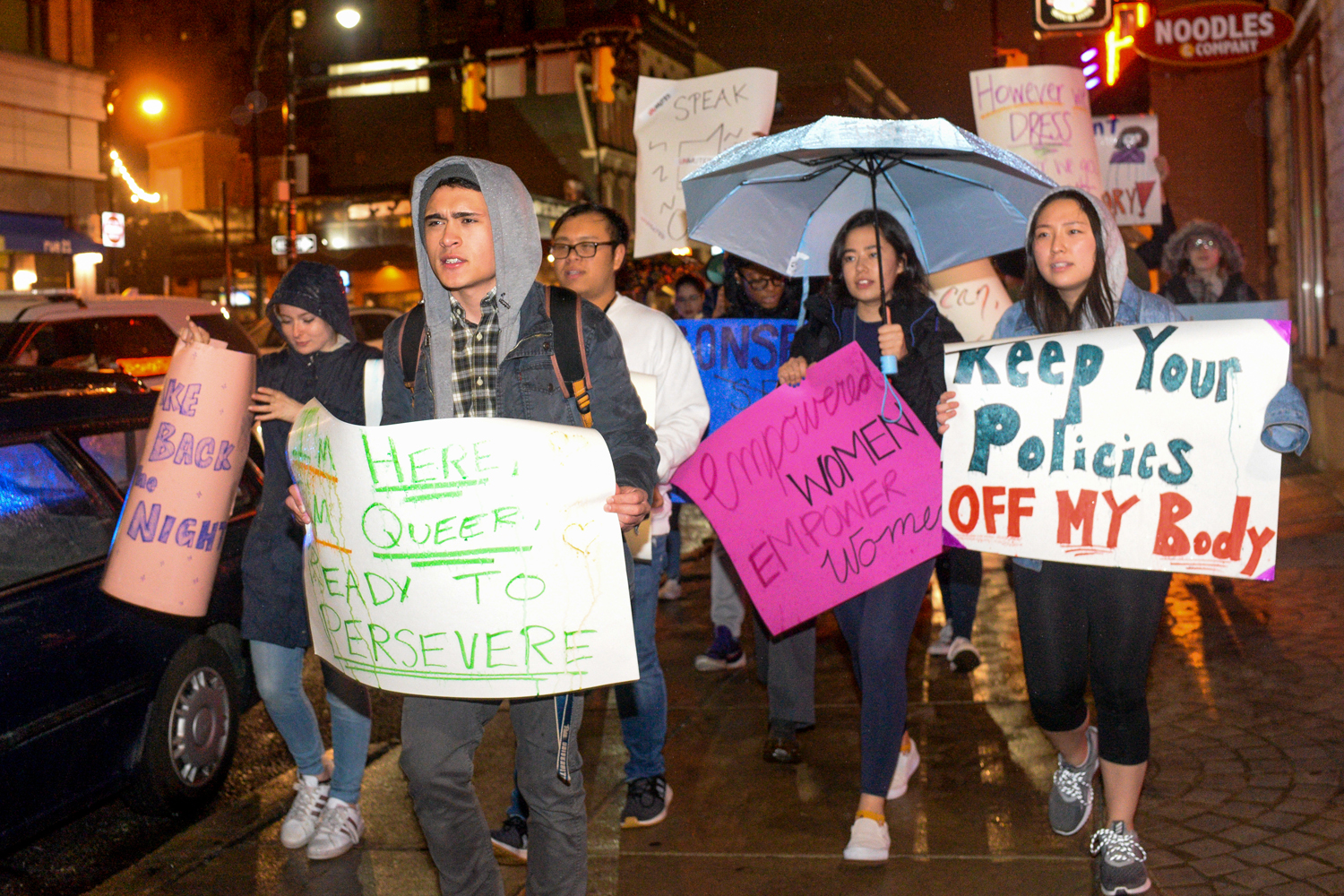 "Eric Macadangdang moves with other demonstrators down Forbes Avenue at Thursday's ""Take Back the Night"" march."