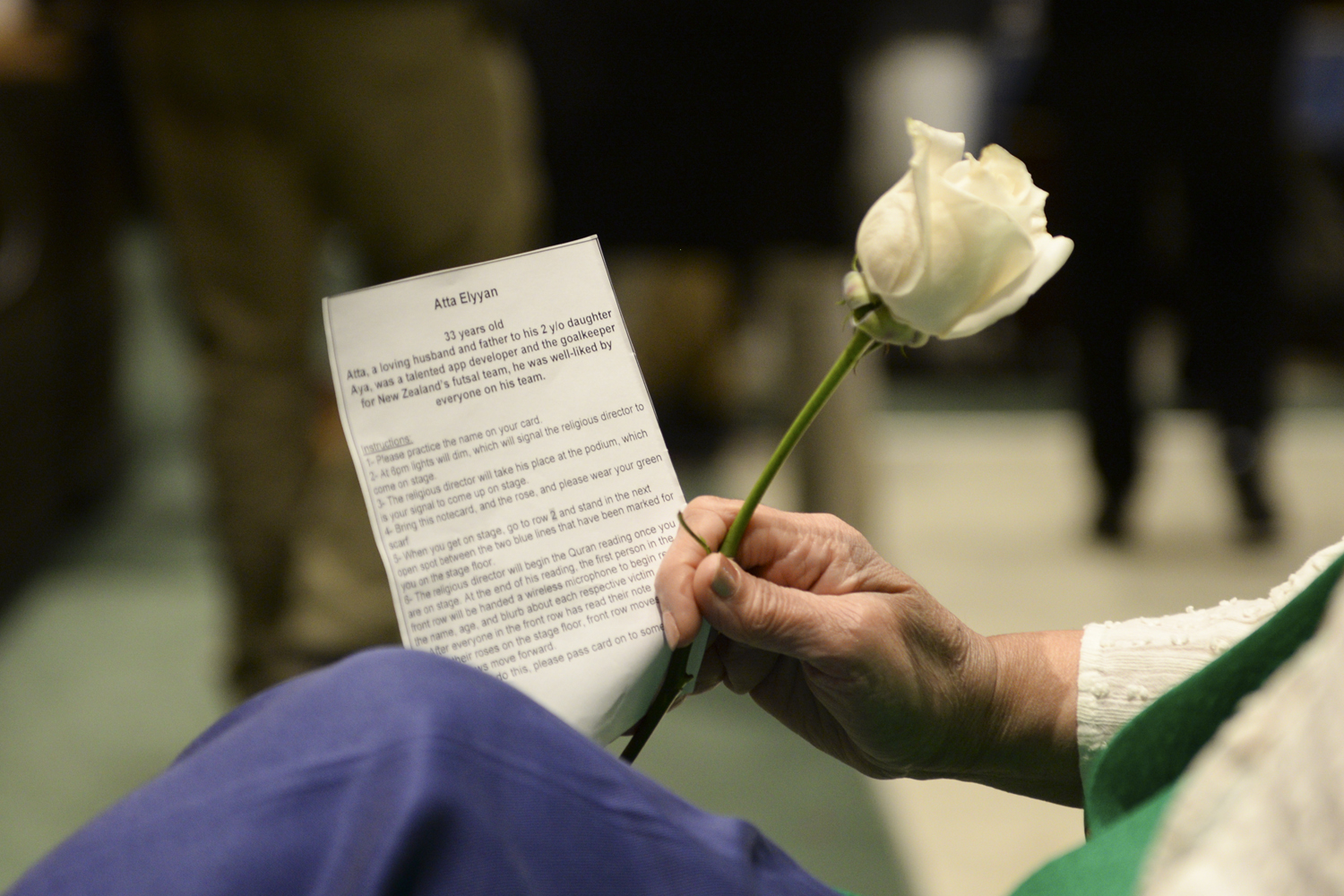 """Rehumanize: A Vigil for Muslims in New Zealand"" began with a ceremony of 50 volunteers going on stage, each holding a white rose to represent one of the victims from the Christchurch shooting."