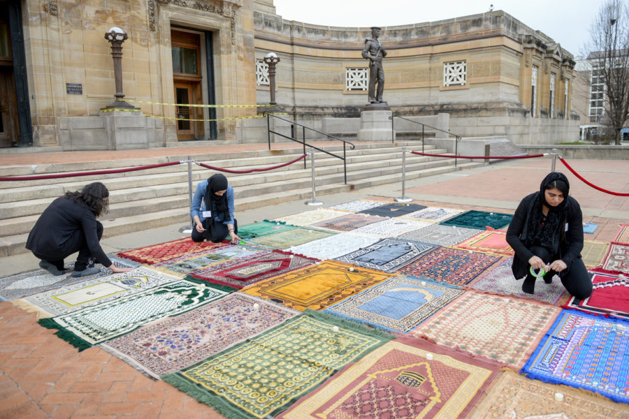 """Prayer rugs laid out at Sunday evening's """"Rehumanize: A Vigil for Muslims in New Zealand"""" memorial."""