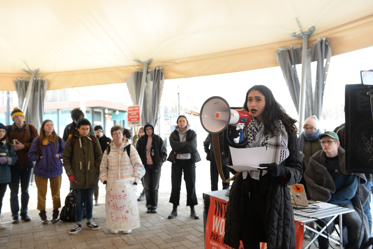 About 100 people gathered in Schenley Plaza to demand reproductive justice, environmental justice and an end to gender violence at Thursday afternoon's student walkout.