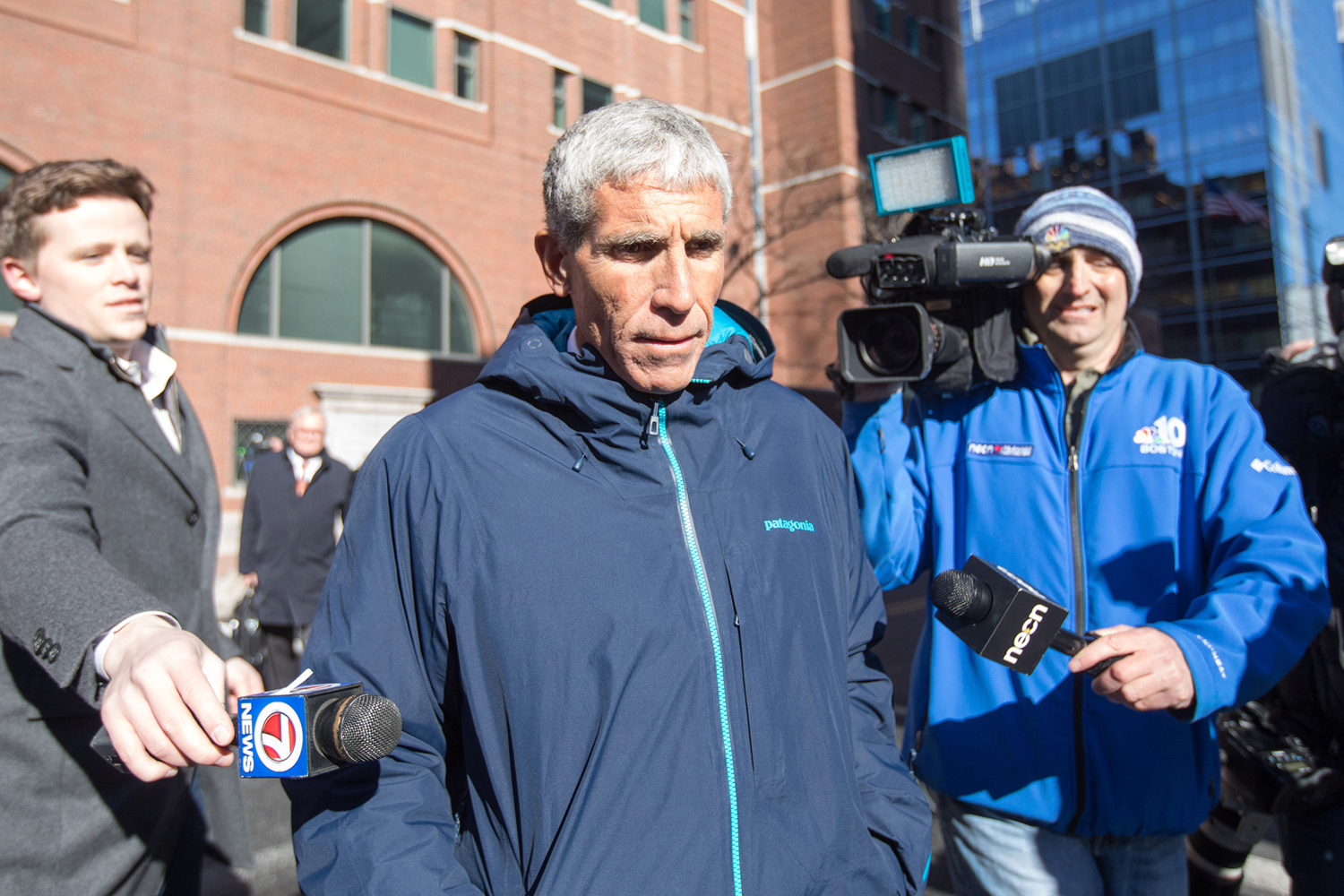 """William """"Rick"""" Singer leaves Boston Federal Court after being charged with racketeering conspiracy, money laundering conspiracy, conspiracy to defraud the United States and obstruction of justice last Tuesday in Boston. Singer is among several charged in an alleged college admissions scam."""