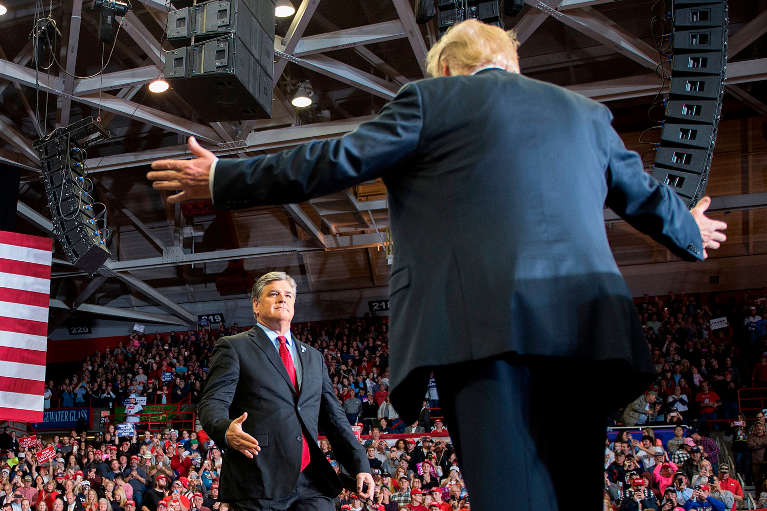 "U.S. President Donald Trump greets Fox News talk show host Sean Hannity at a ""Make America Great Again"" rally in Cape Girardeau, Missouri, on Nov. 5, 2018."