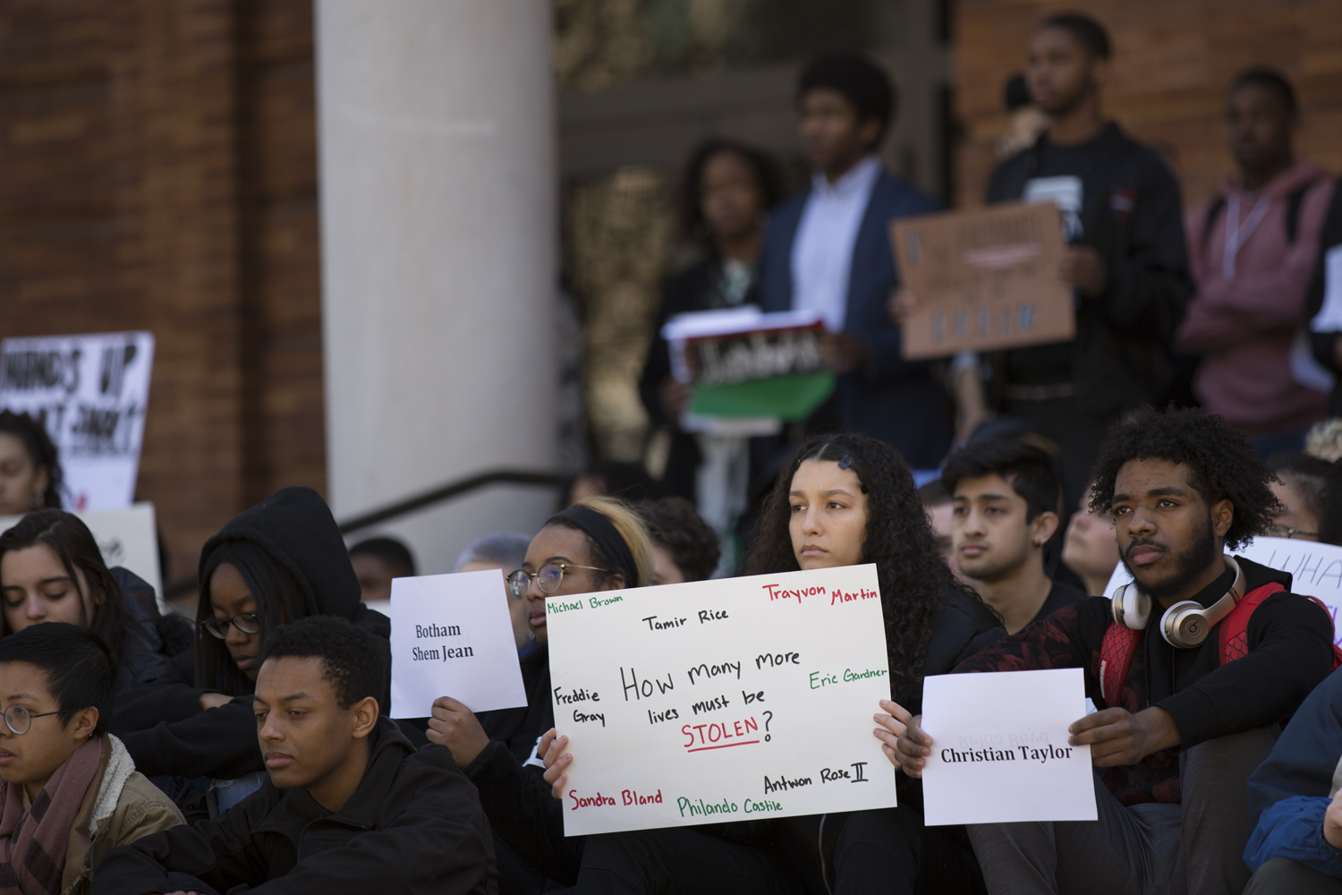 Students sit outside the William Pitt Union  as a part of Black Action Society's die-in demonstration on Wednesday. Protests have occurred on campus and Downtown over the last six days as a result of Michael Rosfeld being found not guilty after being charged with homicide for his June 2018 fatal shooting of Antwon Rose.