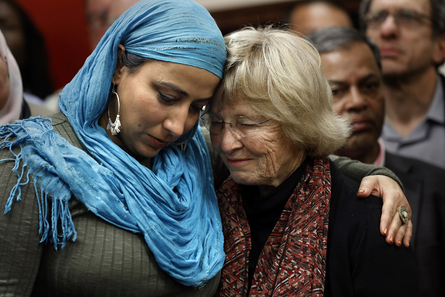 Najeeba Syeed, left, of Los Angeles, hugs Judy Gilliland, of Lakewood, California, during a news conference at The Islamic Center of Los Angeles on Friday, March 15. Muslims and people of all faiths came together in prayer at The Islamic Center of Los Angeles one day after the shooting in a mosque in New Zealand killed 50 people.