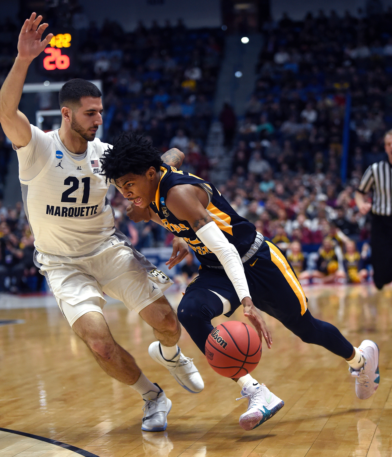 Murray State's Ja Morant drives to the basket against Marquette's Joseph Chartouny (21) in the first round of the NCAA Tournament at the XL Center in Hartford, Connecticut, on Thursday. Murray State advanced, 83-64.