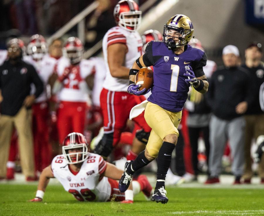 Byron Murphy returns the interception 66 yards for a touchdown in the third quarter against Utah Nov. 30, 2018, in Santa Clara, California. The University of Washington beat the University of Utah 10-3.