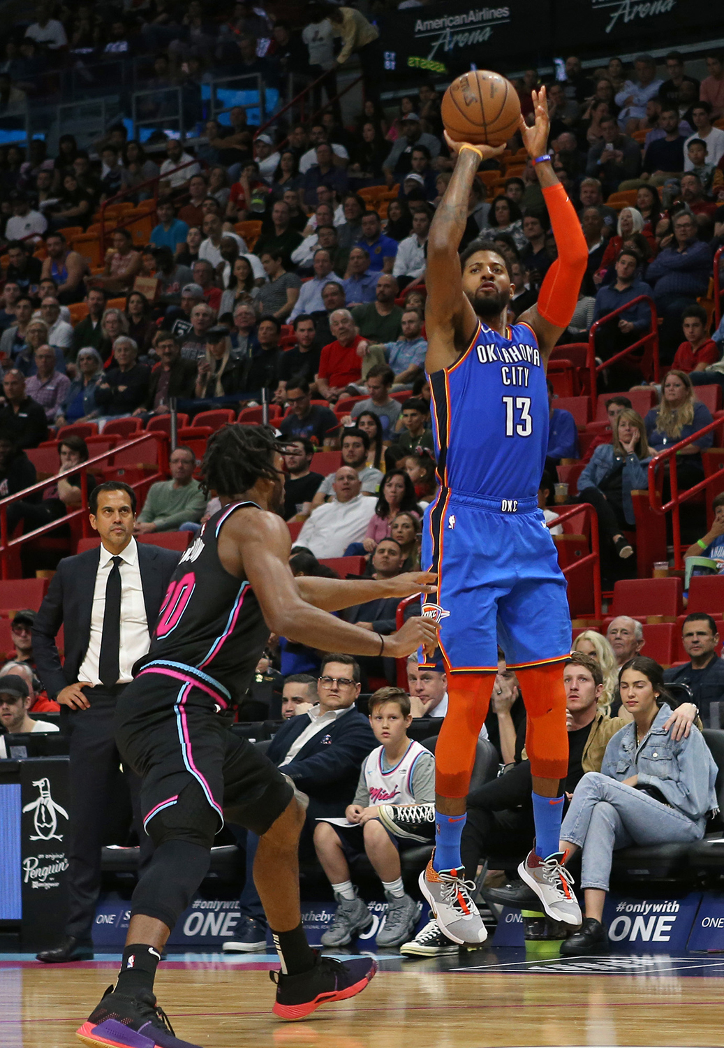 The Oklahoma City Thunder's Paul George (13) shoots over the Miami Heat's Justise Winslow in the third quarter at AmericanAirlines Arena in Miami on Feb. 1. The Thunder won, 118-102.